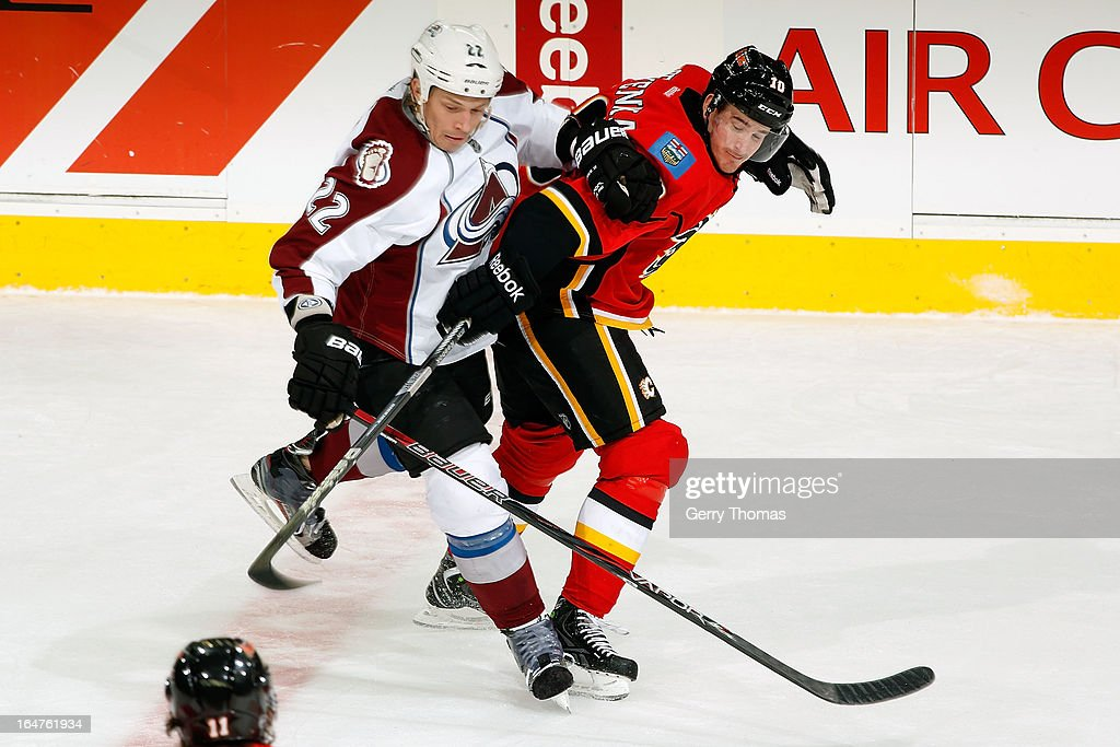 Roman Cervenka #10 of the Calgary Flames skates against Matt Hunwick #22 of the Colorado Avalanche on March 27, 2013 at the Scotiabank Saddledome in Calgary, Alberta, Canada.