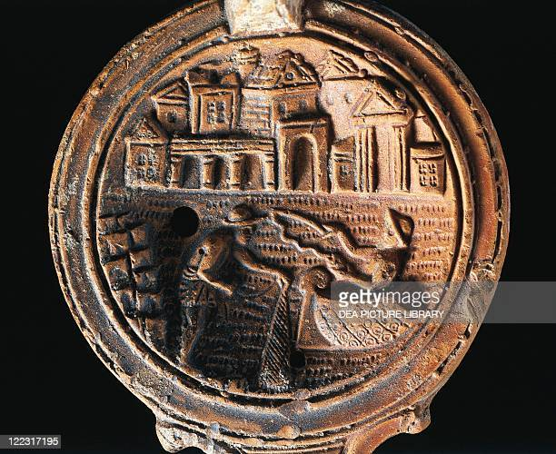 Roman civilization 1st century AD Terracotta oil lamp with relief depicting the Port of Alexandria with the tomb of Alexander and the Mausoleum of...