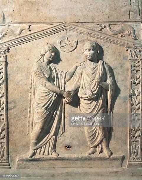 Roman civilization 1st century AD Votive altar depicting a bride and groom at their wedding during the Dextrarum Iunctio rite