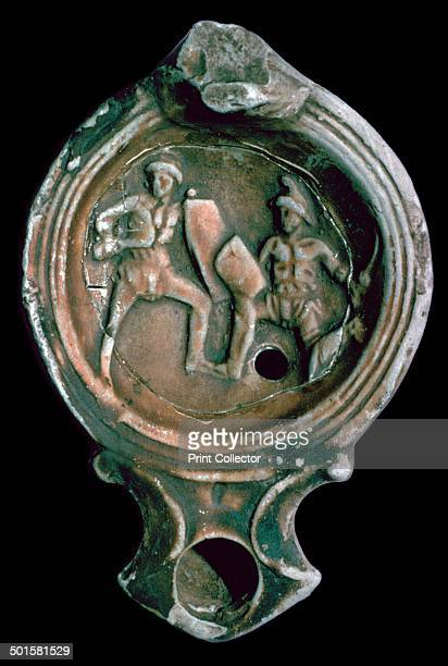 Roman clay lamp from Trier Germany decorated with gladiators 3rd century
