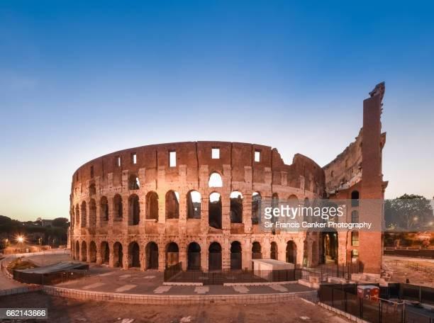 Roman Colosseum (Flavian Amphitheater) illuminated at dusk in Rome, Italy