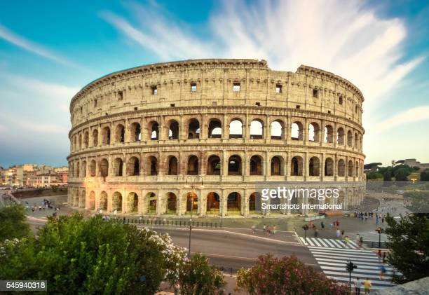 Roman Colosseum (Flavian Amphitheater) with dramatic sky at sunset, Rome, Italy