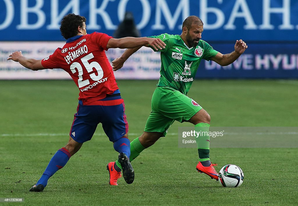 <a gi-track='captionPersonalityLinkClicked' href=/galleries/search?phrase=Roman+Eremenko&family=editorial&specificpeople=4086185 ng-click='$event.stopPropagation()'>Roman Eremenko</a> of PFC CSKA Moscow challenged by <a gi-track='captionPersonalityLinkClicked' href=/galleries/search?phrase=Gokdeniz+Karadeniz&family=editorial&specificpeople=2360972 ng-click='$event.stopPropagation()'>Gokdeniz Karadeniz</a> of FC Rubin Kazan during the Russian Premier League match between PFC CSKA Moscow and FC Rubin Kazan at the Arena Khimki Stadium on July 18, 2015 in Moscow, Russia.