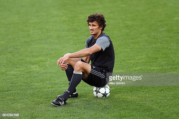 Roman Eremenko sits on a ball during a CSKA Moskva training session ahead of their UEFA Champions League Group E match against Bayer 04 Leverkusen at...