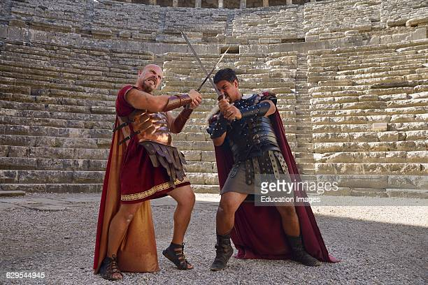 Roman Gladiators sword fighting on the stage at Aspendos theatre Turkey