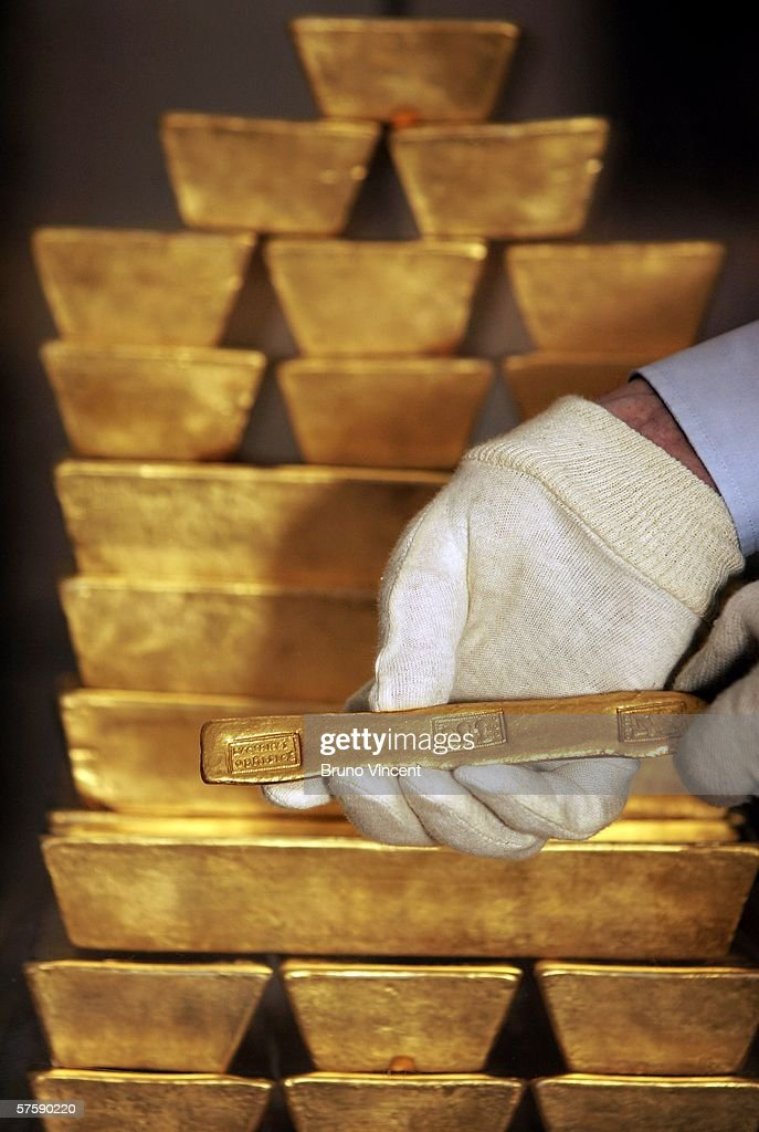 A Roman gold bar fron the 4th century is handled by curator John Keyworth infront of replica modern bars at the Bank of England museum on May 12, 2006 in London, England. The price of gold has risen dramatically over the last few days and is currently valued at GBP153,096 per bar (13 Kg).