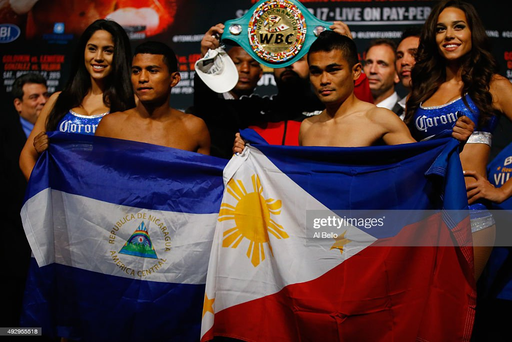 Roman Gonzalez and <a gi-track='captionPersonalityLinkClicked' href=/galleries/search?phrase=Brian+Viloria&family=editorial&specificpeople=850361 ng-click='$event.stopPropagation()'>Brian Viloria</a> pose for Gonzalez's WBC Flyweight Title during the weigh in at Madison Square Garden on October 16, 2015 in New York City.