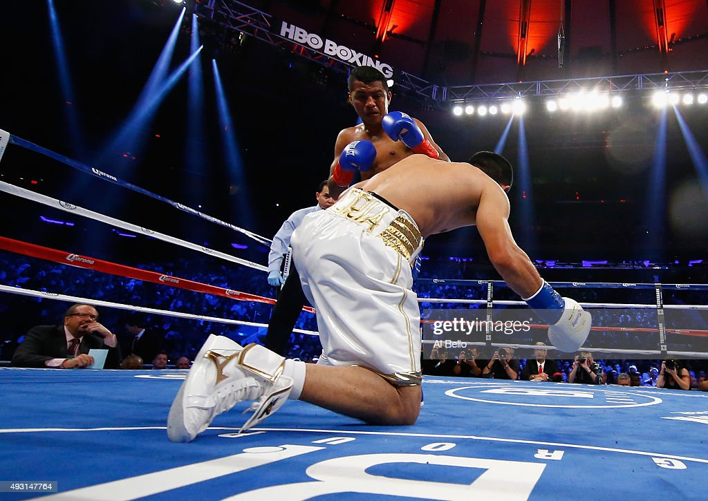 Roman Gonzalez knocks down <a gi-track='captionPersonalityLinkClicked' href=/galleries/search?phrase=Brian+Viloria&family=editorial&specificpeople=850361 ng-click='$event.stopPropagation()'>Brian Viloria</a> during their WBC Flyweight Title fight at Madison Square Garden on October 17, 2015 in New York City.