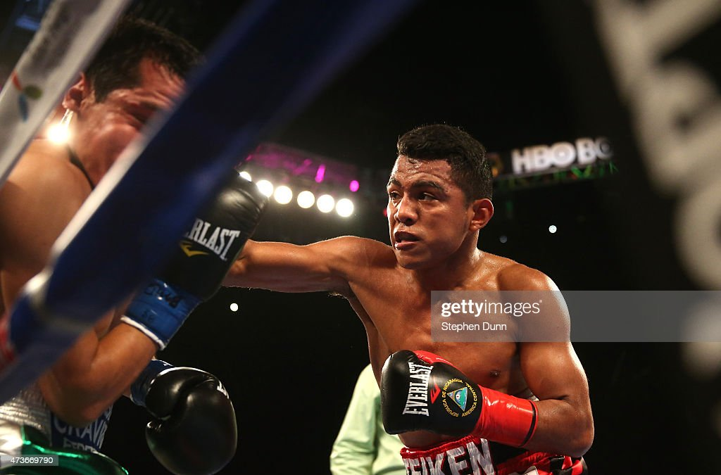 Roman Gonzalez (R) throws a punch in the sequence that knocked out <a gi-track='captionPersonalityLinkClicked' href=/galleries/search?phrase=Edgar+Sosa+-+Boxer&family=editorial&specificpeople=4780973 ng-click='$event.stopPropagation()'>Edgar Sosa</a> in their WBC Flyweight World Championship fight at The Forum on May 16, 2015 in Inglewood, California. Gonzalex won in a second round knockout.