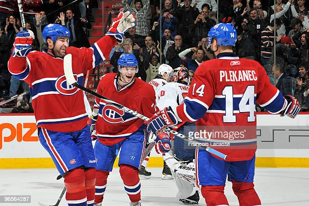 Roman Hamrlik of Montreal Canadiens celebrates with teammate Sergei Kostitsyn the victory goal of Tomas Plekanec during the NHL game against the...