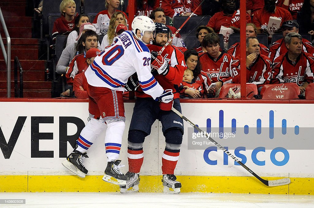 <a gi-track='captionPersonalityLinkClicked' href=/galleries/search?phrase=Roman+Hamrlik&family=editorial&specificpeople=202069 ng-click='$event.stopPropagation()'>Roman Hamrlik</a> #44 of the Washington Capitals is checked by <a gi-track='captionPersonalityLinkClicked' href=/galleries/search?phrase=Chris+Kreider&family=editorial&specificpeople=5894671 ng-click='$event.stopPropagation()'>Chris Kreider</a> #20 of the New York Rangers in Game Four of the Eastern Conference Semifinals during the 2012 NHL Stanley Cup Playoffs at the Verizon Center on May 5, 2012 in Washington, DC.