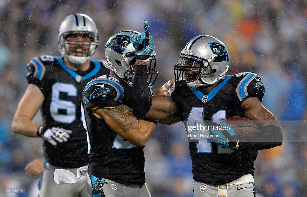 Roman Harper and Kurt Coleman of the Carolina Panthers celebrate a turnover against the Indianapolis Colts in the 1st quarter during their game at...