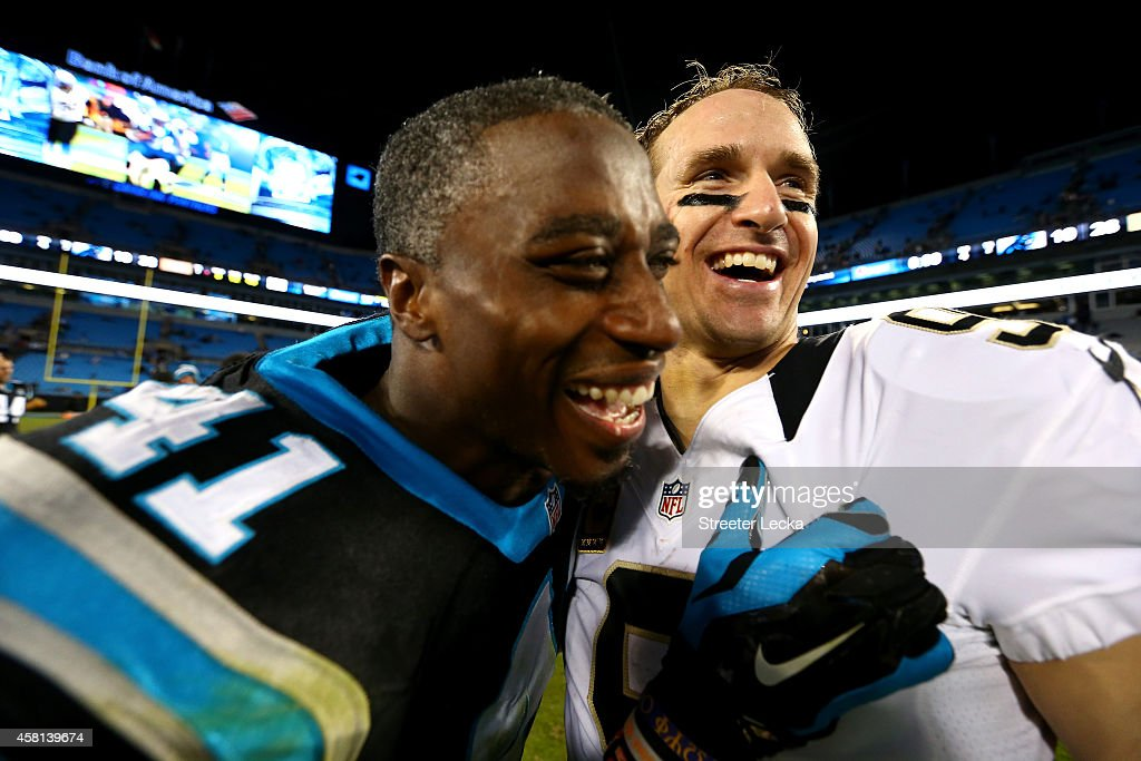 Roman Harper of the Carolina Panthers and Drew Brees of the New Orleans Saints hug after the Saints defeated the Panthers 2810 at Bank of America...