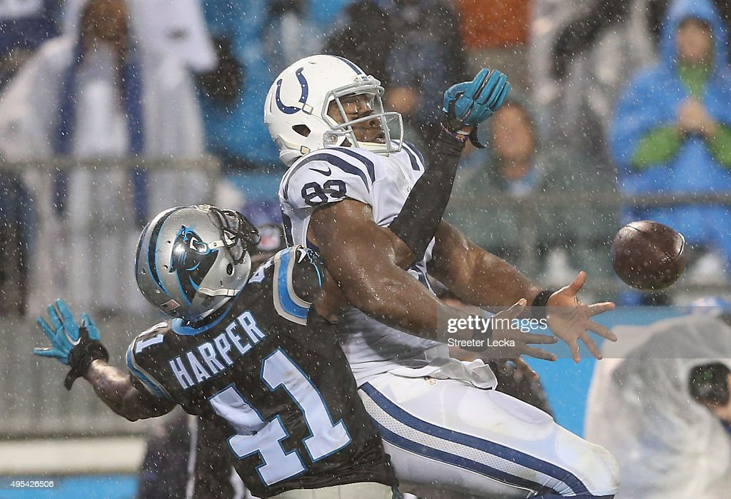 Roman Harper of the Carolina Panthers breaks up a pass to Dwayne Allen of the Indianapolis Colts during their game at Bank of America Stadium on...