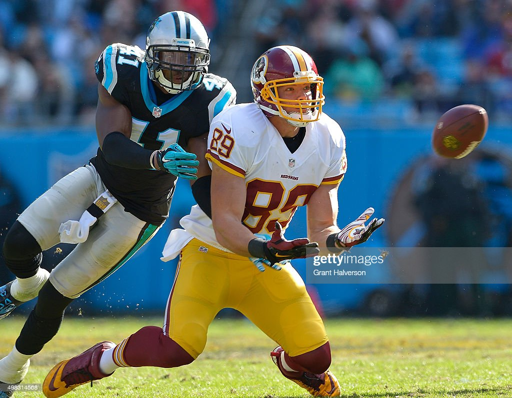 Roman Harper of the Carolina Panthers defends a pass to Derek Carrier of the Washington Redskins during their game at Bank of America Stadium on...