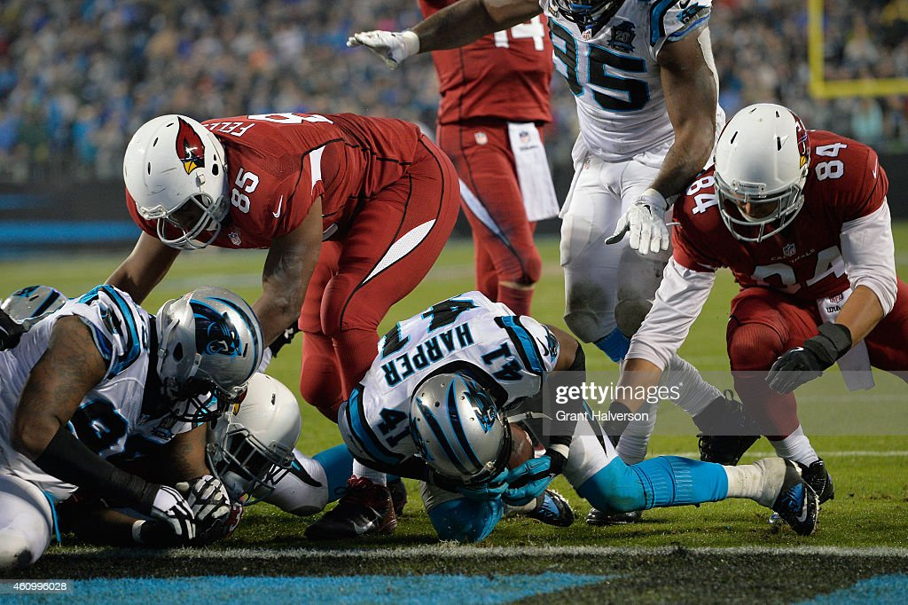 Roman Harper of the Carolina Panthers dives on a loose ball after Marion Grice of the Arizona Cardinals fumbled during their NFC Wild Card Playoff...