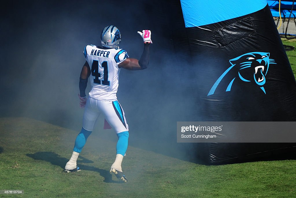 Roman Harper of the Carolina Panthers is introduced before the game against the Chicago Bears on October 5 2014 at Bank of America Stadium in...