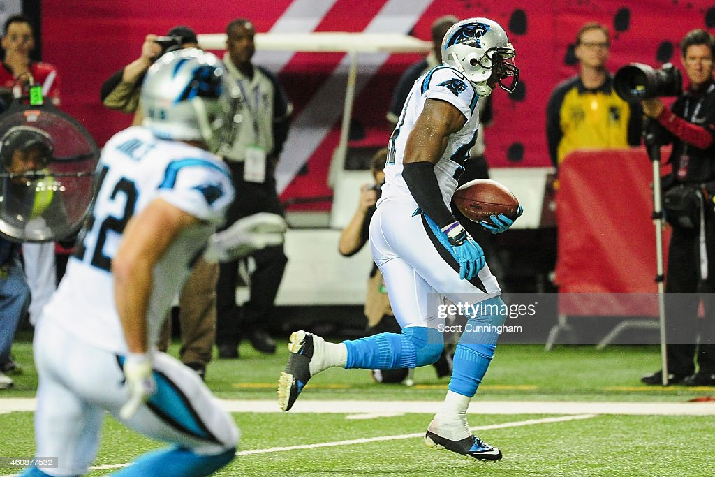 Roman Harper of the Carolina Panthers returns a interception for a touchdown in the first half against the Atlanta Falcons at the Georgia Dome on...