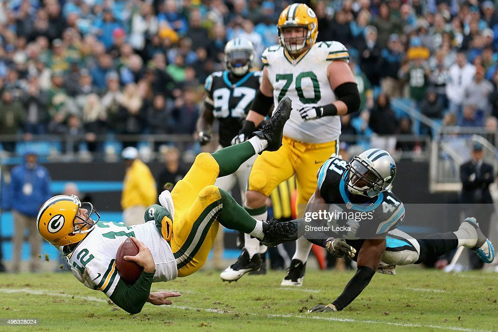 Roman Harper of the Carolina Panthers tackles Aaron Rodgers of the Green Bay Packers during their game at Bank of America Stadium on November 8 2015...