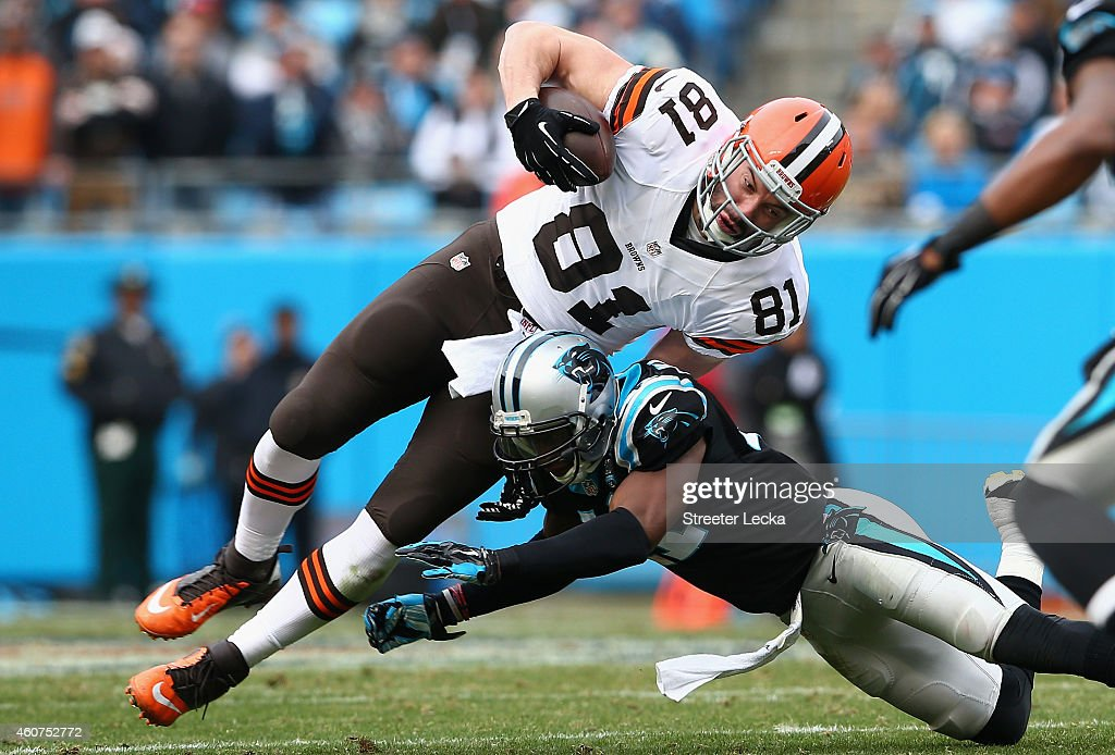 Roman Harper of the Carolina Panthers tackles Jim Dray of the Cleveland Browns in the 3rd quarter during their game at Bank of America Stadium on...