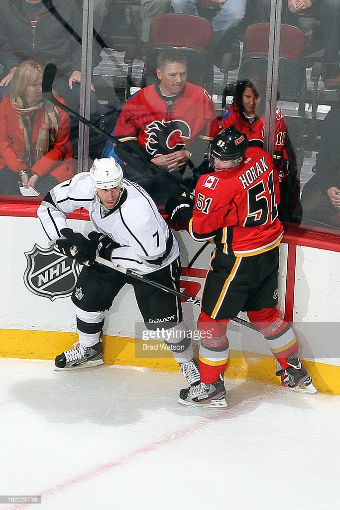 Roman Horak #51 of the Calgary Flames skates against <a gi-track='captionPersonalityLinkClicked' href=/galleries/search?phrase=Rob+Scuderi&family=editorial&specificpeople=228124 ng-click='$event.stopPropagation()'>Rob Scuderi</a> #7 of the Los Angeles Kings on February 20, 2013 at the Scotiabank Saddledome in Calgary, Alberta, Canada.