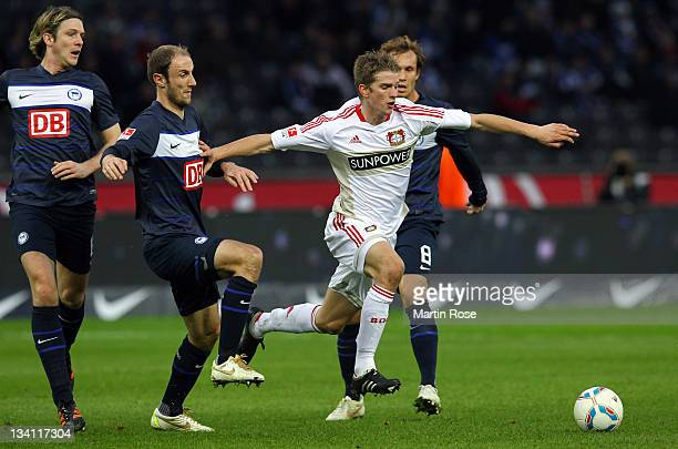 Roman Hubnik of Berlin and Lars Bender of Leverkusen battle for the ball during the Bundesliga match between Hertha BSC Berlin and Bayer 04...