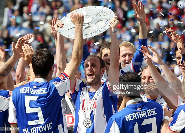 Roman Hubnik of Berlin celebrates with the trophy winning the championship after the Second Bundesliga match between Hertha BSC Berlin and FC...