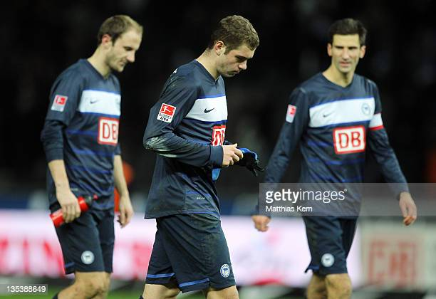 Roman Hubnik Pierre Michel Lasogga and Andre Mijatovic of Berlin show their frustration after loosing the Bundesliga match between Hertha BSC Berlin...
