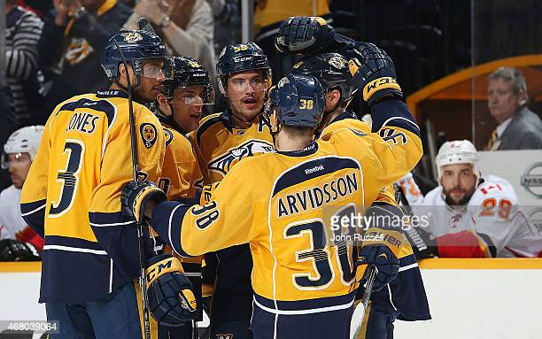 Roman Josi celebrates his goal with Viktor Arvidsson and Seth Jones of the Nashville Predators against the Calgary Flames during an NHL game at...