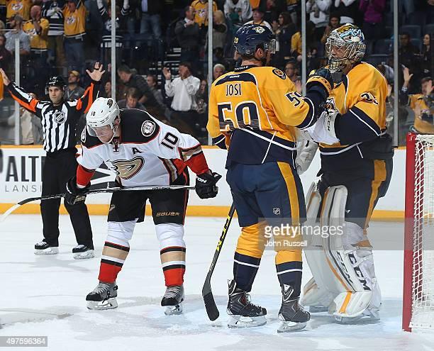 Roman Josi congratulates Pekka Rinne of the Nashville Predators on a win against Corey Perry of the Anaheim Ducks during an NHL game at Bridgestone...