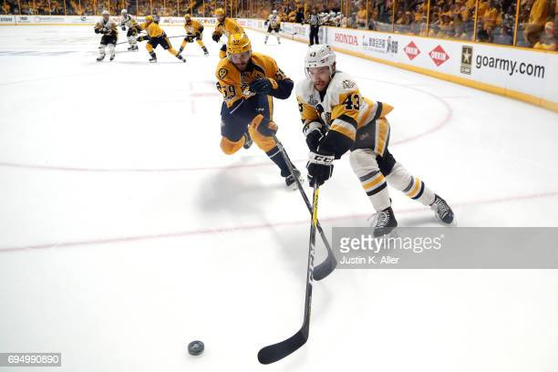 Roman Josi of the Nashville Predators and Conor Sheary of the Pittsburgh Penguins battle for the puck during the second period in Game Six of the...