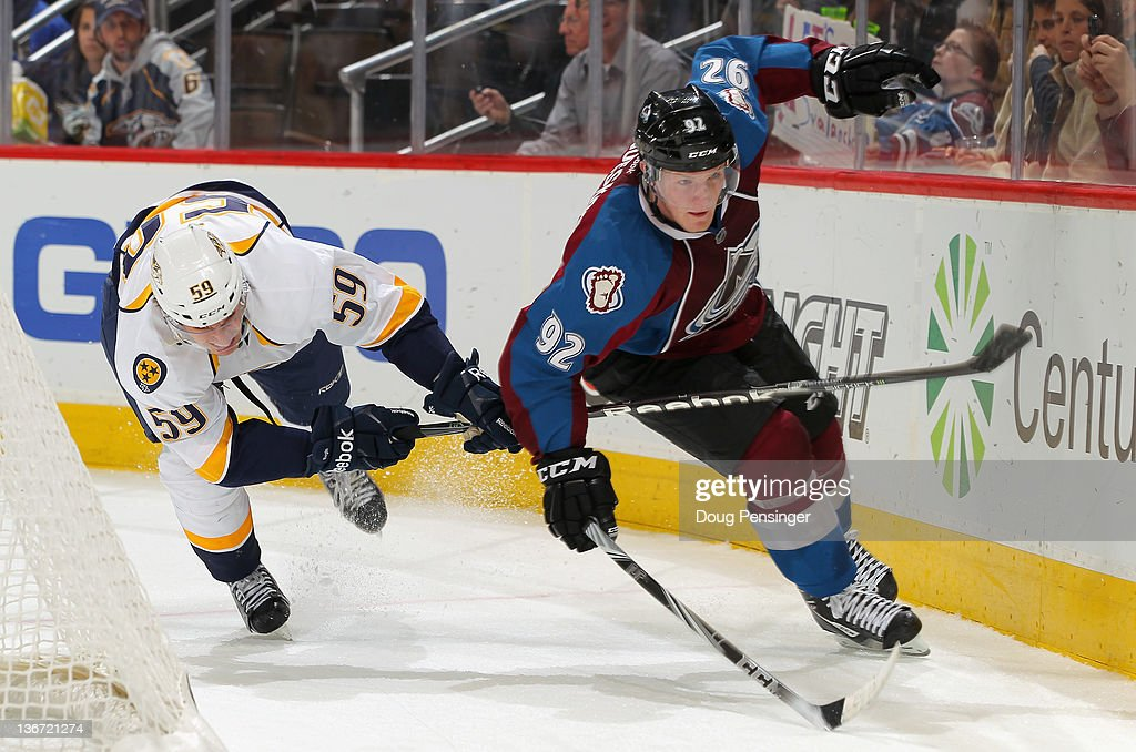 Roman Josi #59 of the Nashville Predators and Gabriel Landeskog #92 of the Colorado Avalanche pursue the puck at the Pepsi Center on January 10, 2012 in Denver, Colorado. The Predators defeated the Avalanche 4-1.