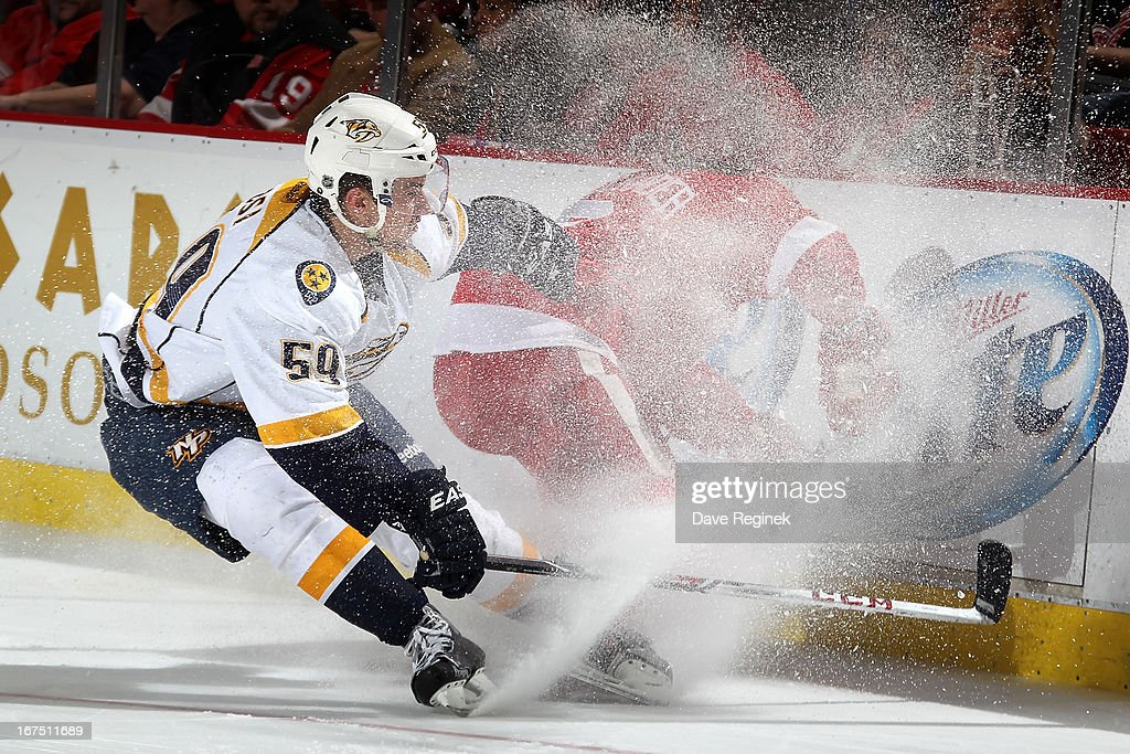 <a gi-track='captionPersonalityLinkClicked' href=/galleries/search?phrase=Roman+Josi&family=editorial&specificpeople=4247871 ng-click='$event.stopPropagation()'>Roman Josi</a> #59 of the Nashville Predators and <a gi-track='captionPersonalityLinkClicked' href=/galleries/search?phrase=Justin+Abdelkader&family=editorial&specificpeople=2271858 ng-click='$event.stopPropagation()'>Justin Abdelkader</a> #8 of the Detroit Red Wings go after the puck along the boards during a NHL game at Joe Louis Arena on April 25, 2013 in Detroit, Michigan. Detroit defeated Nashville 5-2