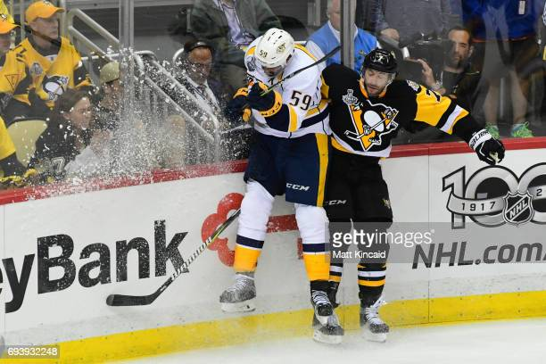 Roman Josi of the Nashville Predators and Matt Cullen of the Pittsburgh Penguins collide during the third period in Game Five of the 2017 NHL Stanley...