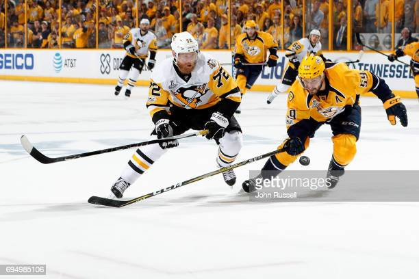 Roman Josi of the Nashville Predators and Patric Hornqvist of the Pittsburgh Penguins go for the puck during Game Six of the 2017 NHL Stanley Cup...