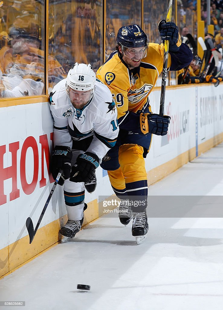 <a gi-track='captionPersonalityLinkClicked' href=/galleries/search?phrase=Roman+Josi&family=editorial&specificpeople=4247871 ng-click='$event.stopPropagation()'>Roman Josi</a> #59 of the Nashville Predators battles along the boards against <a gi-track='captionPersonalityLinkClicked' href=/galleries/search?phrase=Nick+Spaling&family=editorial&specificpeople=4112920 ng-click='$event.stopPropagation()'>Nick Spaling</a> #16 of the San Jose Sharks in Game Four of the Western Conference Second Round during the 2016 NHL Stanley Cup Playoffs at Bridgestone Arena on May 5, 2016 in Nashville, Tennessee.