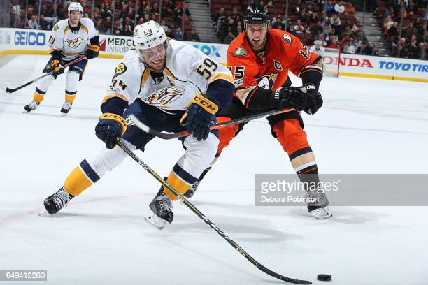 Roman Josi of the Nashville Predators battles for the puck against Ryan Getzlaf of the Anaheim Ducks during the game on March 7 2017 at Honda Center...