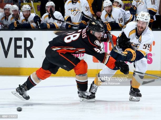Roman Josi of the Nashville Predators battles for the puck against Nic Kerdiles of the Anaheim Ducks in Game Five of the Western Conference Final...