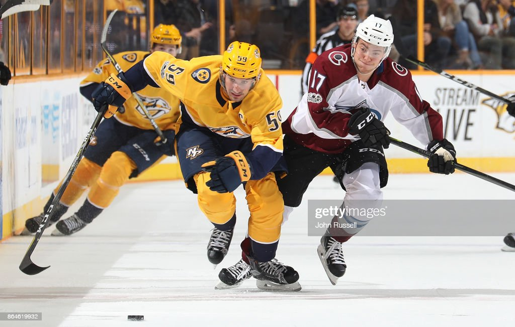 Roman Josi #59 of the Nashville Predators battles for the puck against Tyson Jost #17 of the Colorado Avalanche during an NHL game at Bridgestone Arena on October 17, 2017 in Nashville, Tennessee.