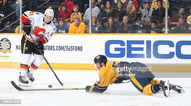 Roman Josi of the Nashville Predators blocks the pass of Mikael Backlund of the Calgary Flames during an NHL game at Bridgestone Arena on March 29...