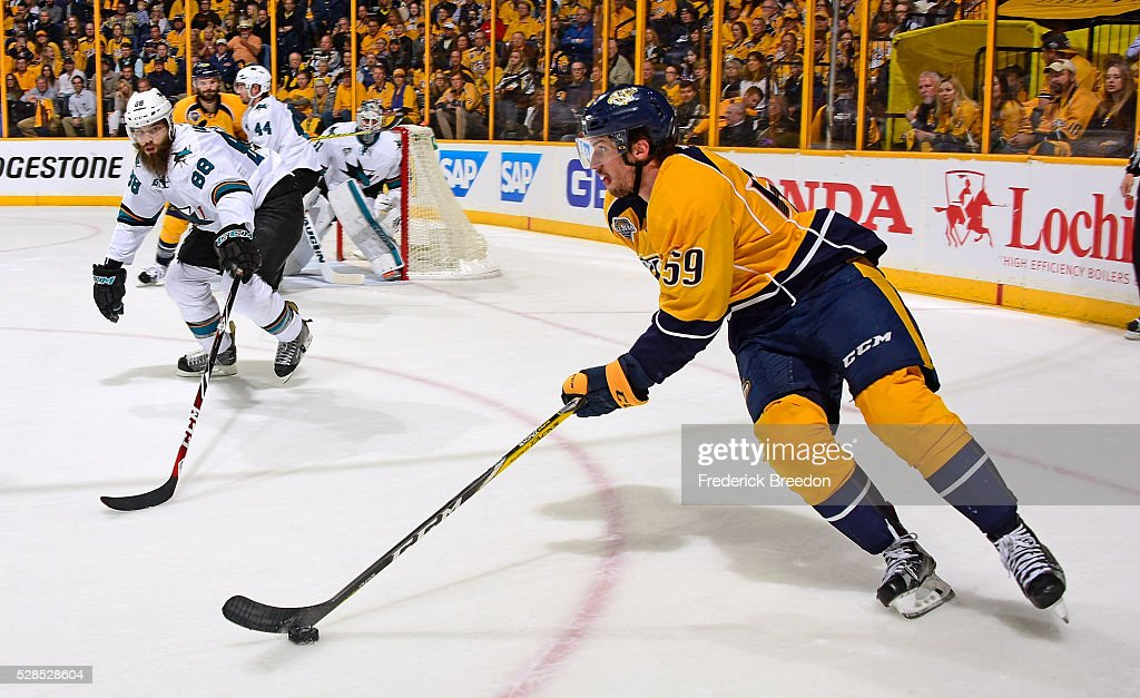 <a gi-track='captionPersonalityLinkClicked' href=/galleries/search?phrase=Roman+Josi&family=editorial&specificpeople=4247871 ng-click='$event.stopPropagation()'>Roman Josi</a> #59 of the Nashville Predators carries the puck out of reach of <a gi-track='captionPersonalityLinkClicked' href=/galleries/search?phrase=Brent+Burns&family=editorial&specificpeople=212883 ng-click='$event.stopPropagation()'>Brent Burns</a> #88 of the San Jose Sharks during the first period of Game Four of the Western Conference Second Round during the 2016 NHL Stanley Cup Playoffs at Bridgestone Arena on May 5, 2016 in Nashville, Tennessee.
