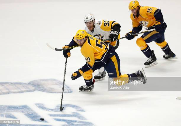 Roman Josi of the Nashville Predators Carter Rowney of the Pittsburgh Penguins and Craig Smith of the Nashville Predators in Game Three of the 2017...