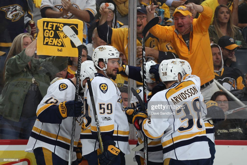 Roman Josi #59 of the Nashville Predators celebrates with teammate Pontus Aberg #46 after Aberg's first period goal in Game Two of the 2017 NHL Stanley Cup Final against the Pittsburgh Penguins at PPG Paints Arena on May 31, 2017 in Pittsburgh, Pennslyvannia.