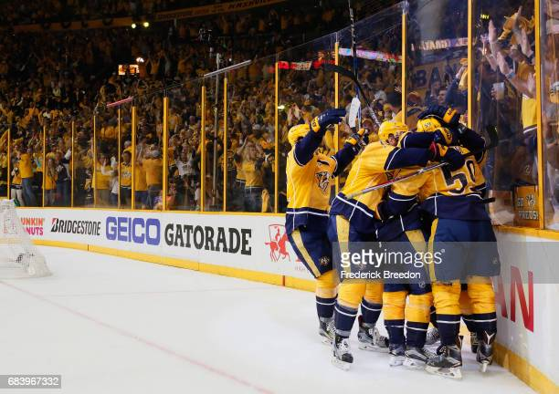 Roman Josi of the Nashville Predators celebrates with teammates after scoring a goal against John Gibson of the Anaheim Ducks during the third period...