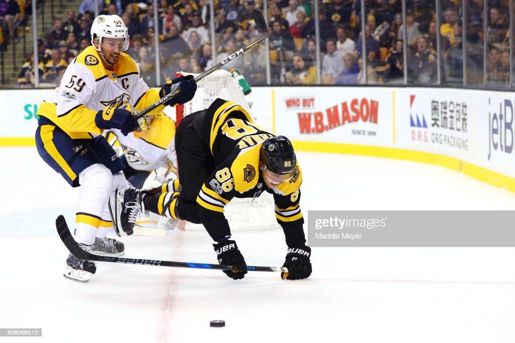 Roman Josi #59 of the Nashville Predators checks David Pastrnak #88 of the Boston Bruins during the third period at TD Garden on October 5, 2017 in Boston, Massachusetts. The Bruins defeat the Predators 4-3.