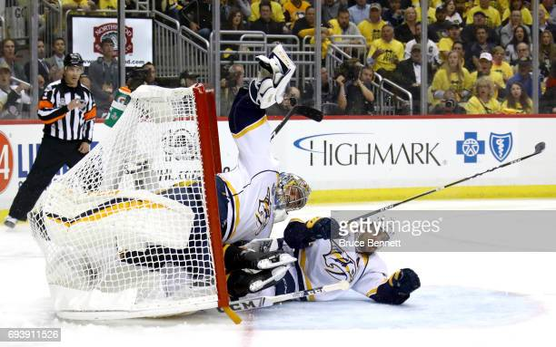Roman Josi of the Nashville Predators collides with goalie Pekka Rinne in the first period against the Pittsburgh Penguins in Game Five of the 2017...