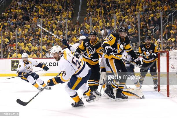 Roman Josi of the Nashville Predators competes with Scott Wilson and Ron Hainsey of the Pittsburgh Penguins in the first period in Game Five of the...