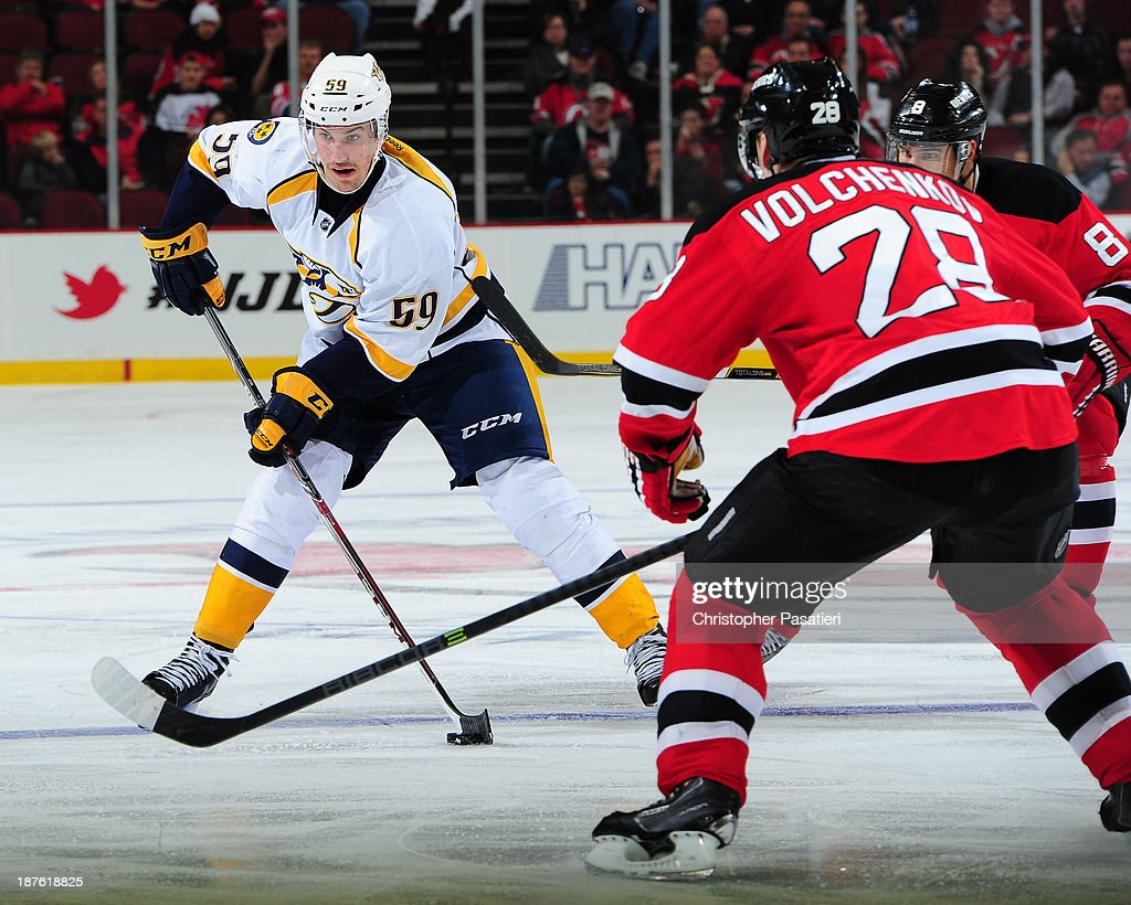<a gi-track='captionPersonalityLinkClicked' href=/galleries/search?phrase=Roman+Josi&family=editorial&specificpeople=4247871 ng-click='$event.stopPropagation()'>Roman Josi</a> #59 of the Nashville Predators controls the puck against <a gi-track='captionPersonalityLinkClicked' href=/galleries/search?phrase=Anton+Volchenkov&family=editorial&specificpeople=210890 ng-click='$event.stopPropagation()'>Anton Volchenkov</a> #28 of the New Jersey Devils during the third period on November 10, 2013 at the Prudential Center in Newark, New Jersey.