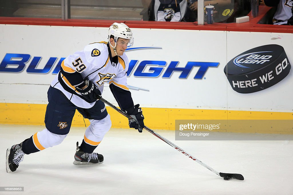 <a gi-track='captionPersonalityLinkClicked' href=/galleries/search?phrase=Roman+Josi&family=editorial&specificpeople=4247871 ng-click='$event.stopPropagation()'>Roman Josi</a> #59 of the Nashville Predators controls the puck against the Colorado Avalanche at the Pepsi Center on March 30, 2013 in Denver, Colorado. The Avalanche defeated the Predators 1-0 in overtime.