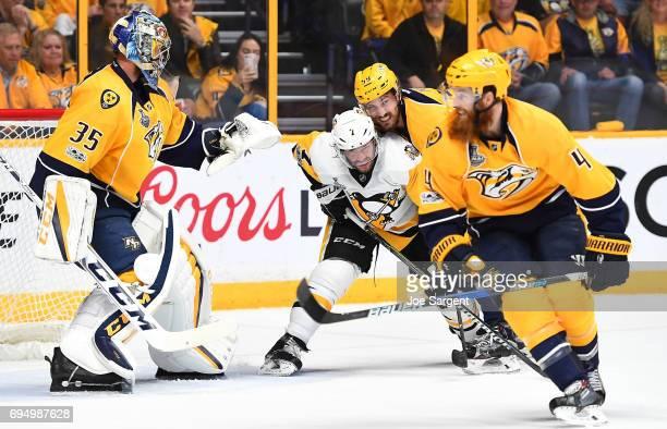 Roman Josi of the Nashville Predators defends Matt Cullen of the Pittsburgh Penguins in front of goaltender Pekka Rinne of the Nashville Predators in...
